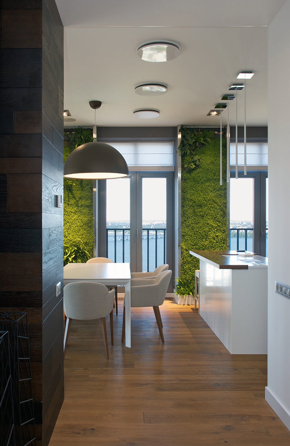 As we approach the entrance to the dining room, we see that the left wall transitions back to a rich wooden panel. This is also our first glimpse of the green walls that give this home its moniker.