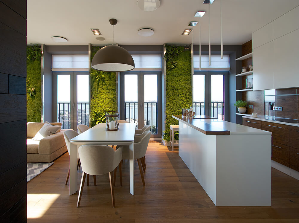 From this angle, we can see the entirety of the dining room, which sits squarely between the living room and the lovely kitchen. The kitchen is in sleek minimalistic white and rich, warm-toned wood.