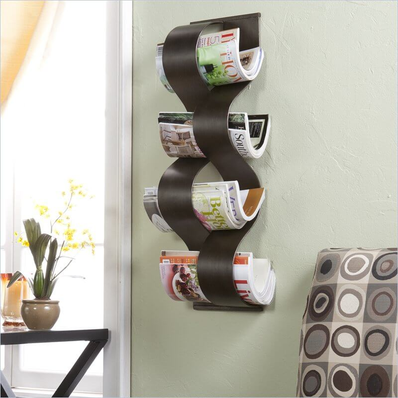 This much more decorative magazine rack holds the magazines neatly between each curve.