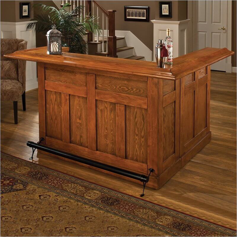 This all-wood mini bar is a more permanent installation, and features a foot bar should you want to add barstools to the mix.