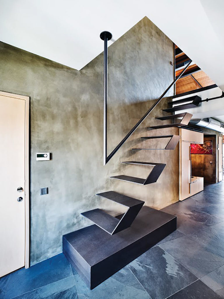 The ultra low profile and exotic nature of the staircase makes it both stand out and practically disappear in the home. Striking as its own design, the thin nature allows for clean visual lines right through the area.