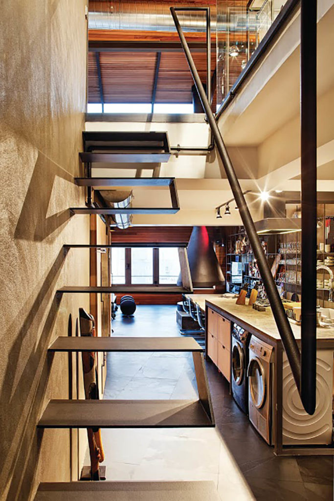 As we can see from this angle, with only thin metal steps forming the staircase, we can see straight through into the kitchen and beyond.