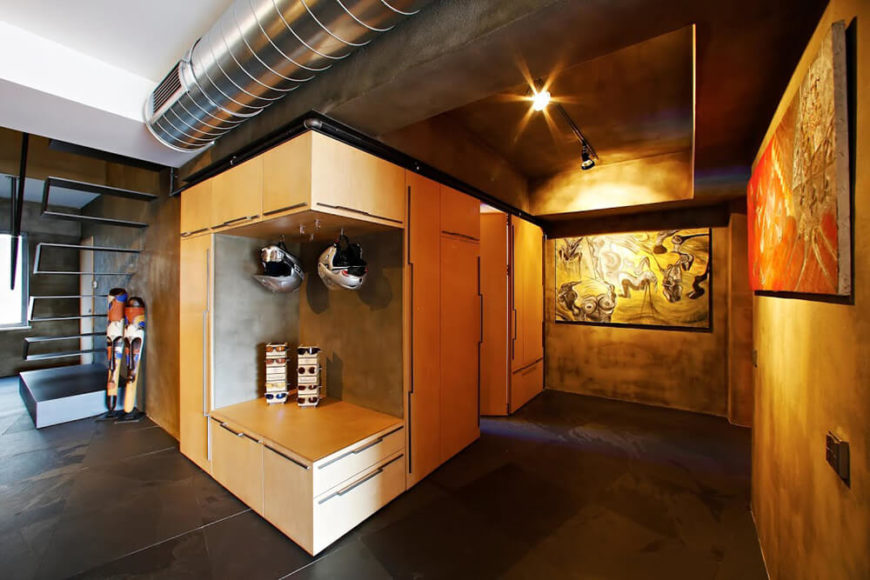 At the center of the project, artwork and other items are displayed prominently in one of the only closed areas of the home.