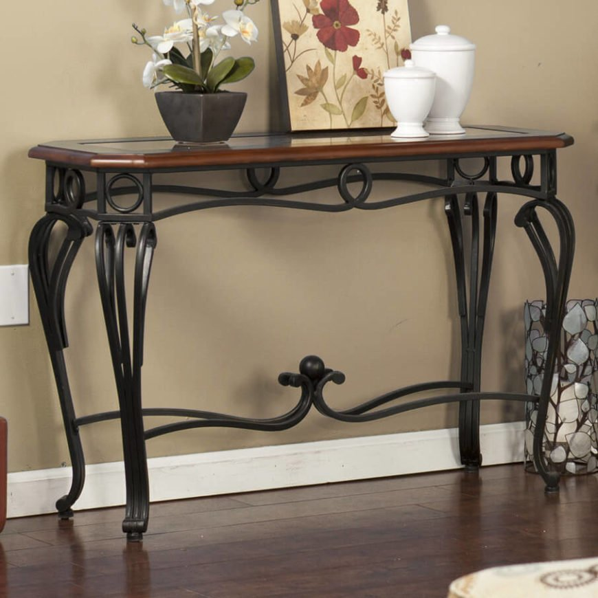 The swirls and curves of the wrought iron frame are incredibly elegant, adding to the charm of the wood-framed glass top. All together, this table makes for a stunning display item.