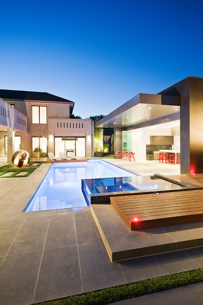 Turning back toward the courtyard and pool, we can take in the abundance of varying textures and materials, integrated into a mosaic of clean modern lines and open spaces.
