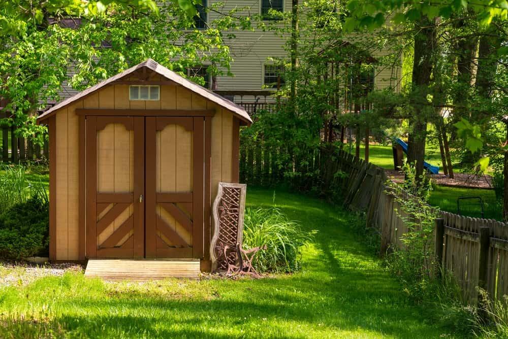 Storage shed in a green backyard.