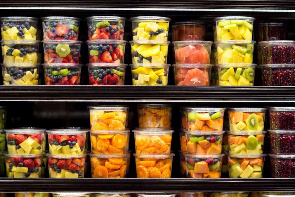 Fruits stored in stackable food containers.