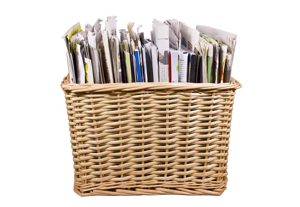 A woven basket full of magazines.