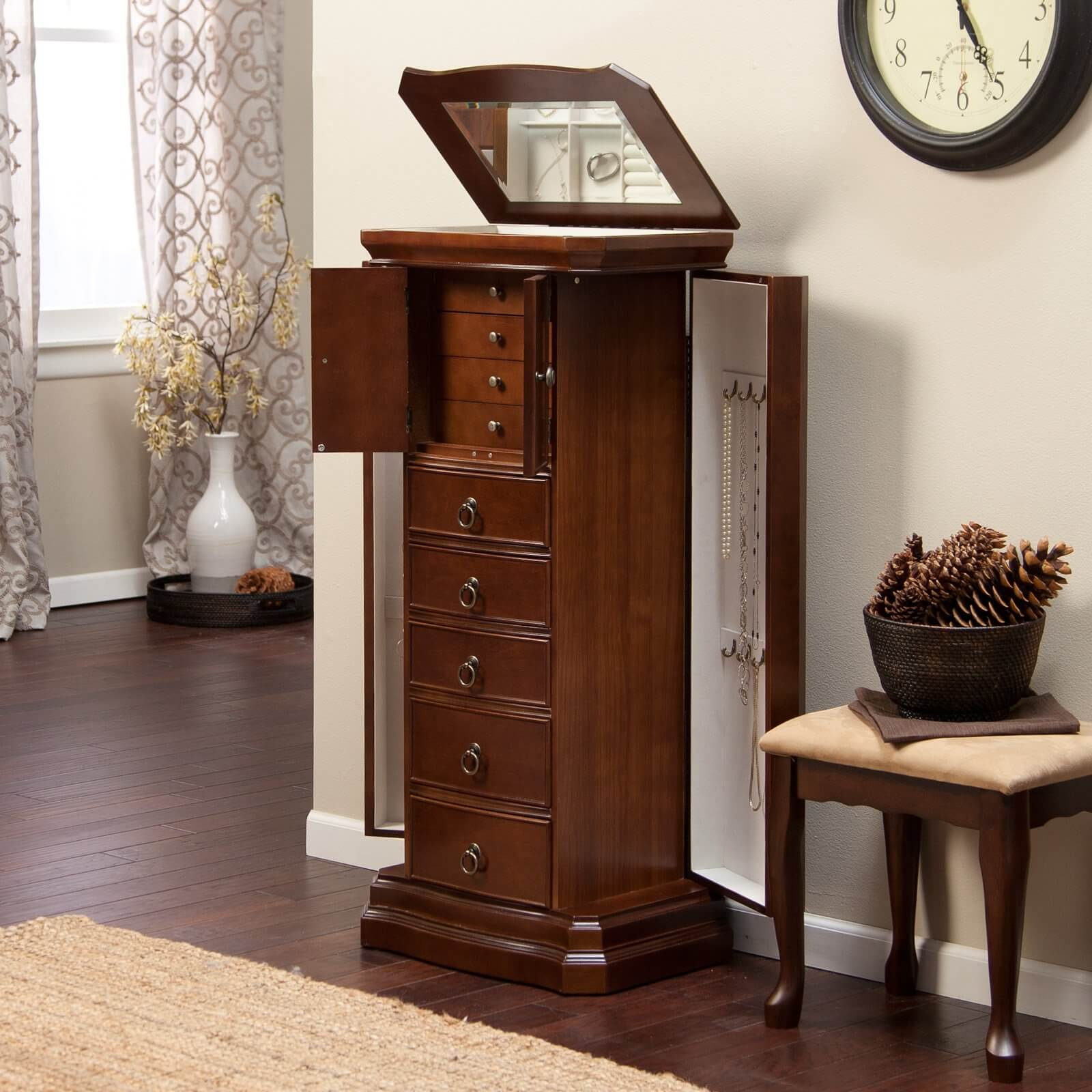 This elegant wooden option features a number of drawers in varying sizes, along with two doors on either side that open to reveal necklace storage. The top conceals ring storage and a mirror.