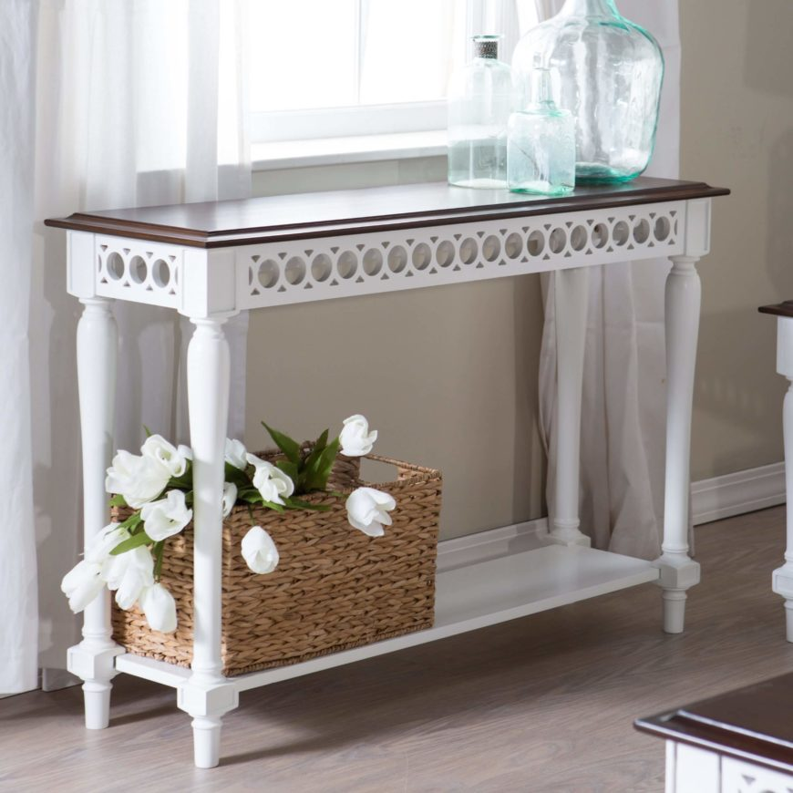 Delicate circles in a repeating pattern adds elegance to this white and wood console table. A lower shelf provides extra storage for purses, or even shoes. The beveled top adds even more elegance to the design.