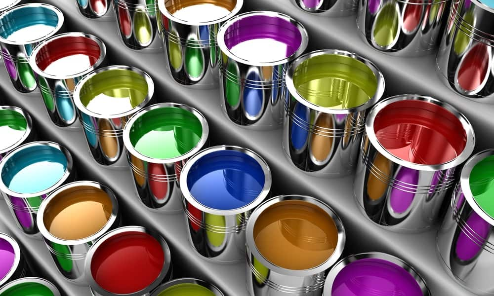 A display of cans of paint in various colors.