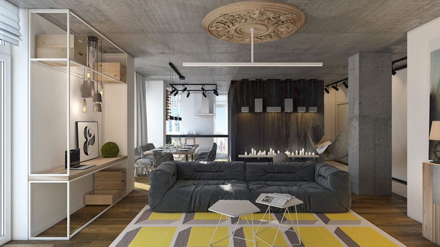 The gorgeous shot from the far side of the room shows off the open flow of the main area of the apartment. The living room flows into the dining room and a small sitting area. Natural and exposed materials make for stunning texture changes throughout the apartment.