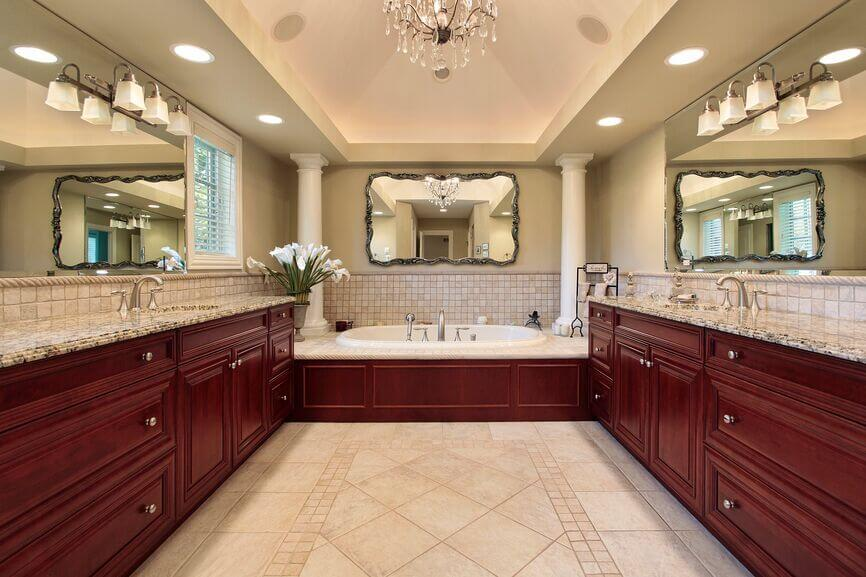Rich red wood throughout this bathroom creates a thoroughly luxurious effect.