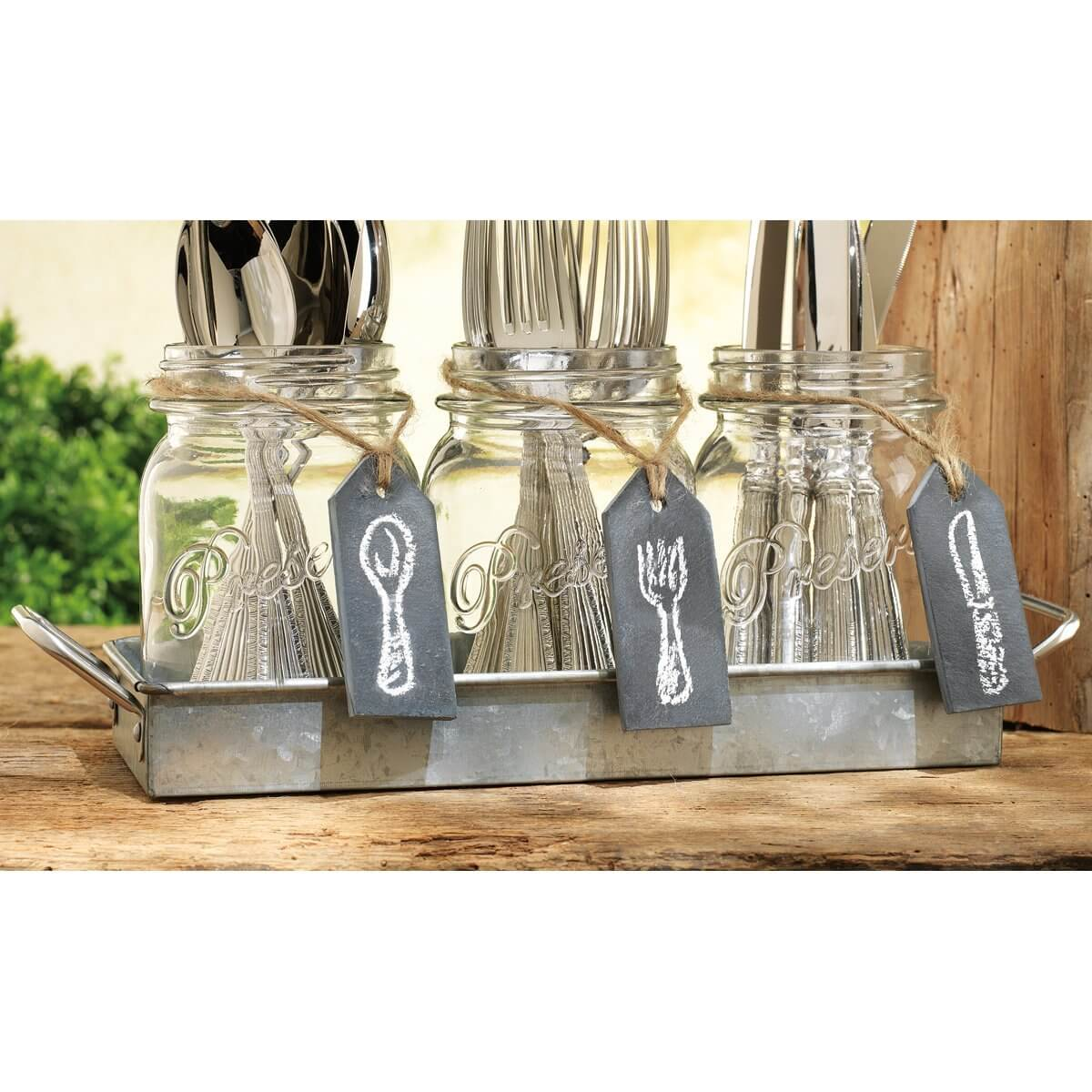 If you're looking for a neat way to store your silverware, a small tray with mason jars will keep your utensils organized and within easy reach.