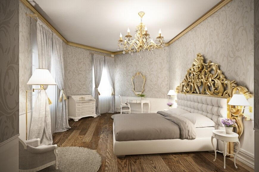 This glamorous bedroom accents the white furniture with shades of warm grey and bright gold. The stunning wood floor is the perfect break in pale decor without taking away from the luxury of the room.