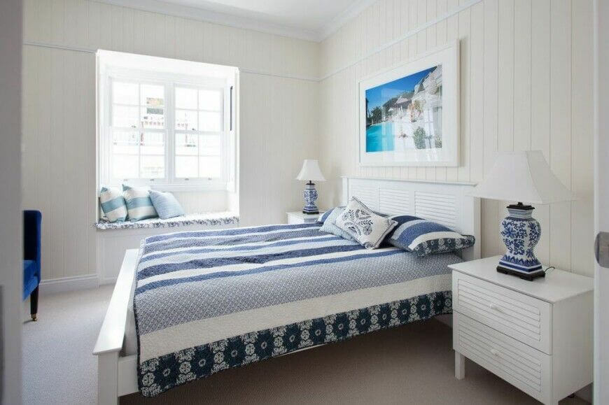 White and blue is a classic color scheme and this room makes effective work of it. The bold blue chair just visible in the corner is a gorgeous addition to the white furniture.