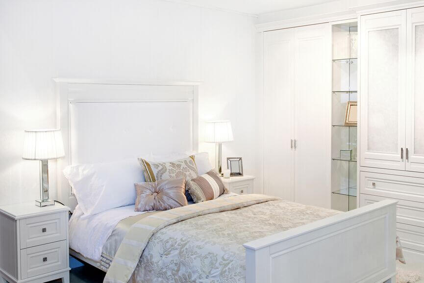 This glamorous room uses subtle, muted accents to offset the use of some much white.