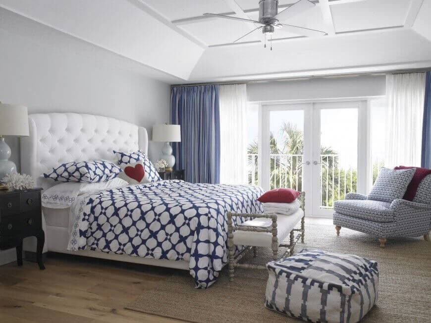 Another lovely use of white and blue. Bold patterns in this room keep the use of blue interesting while a few splash of red help to ground the space.