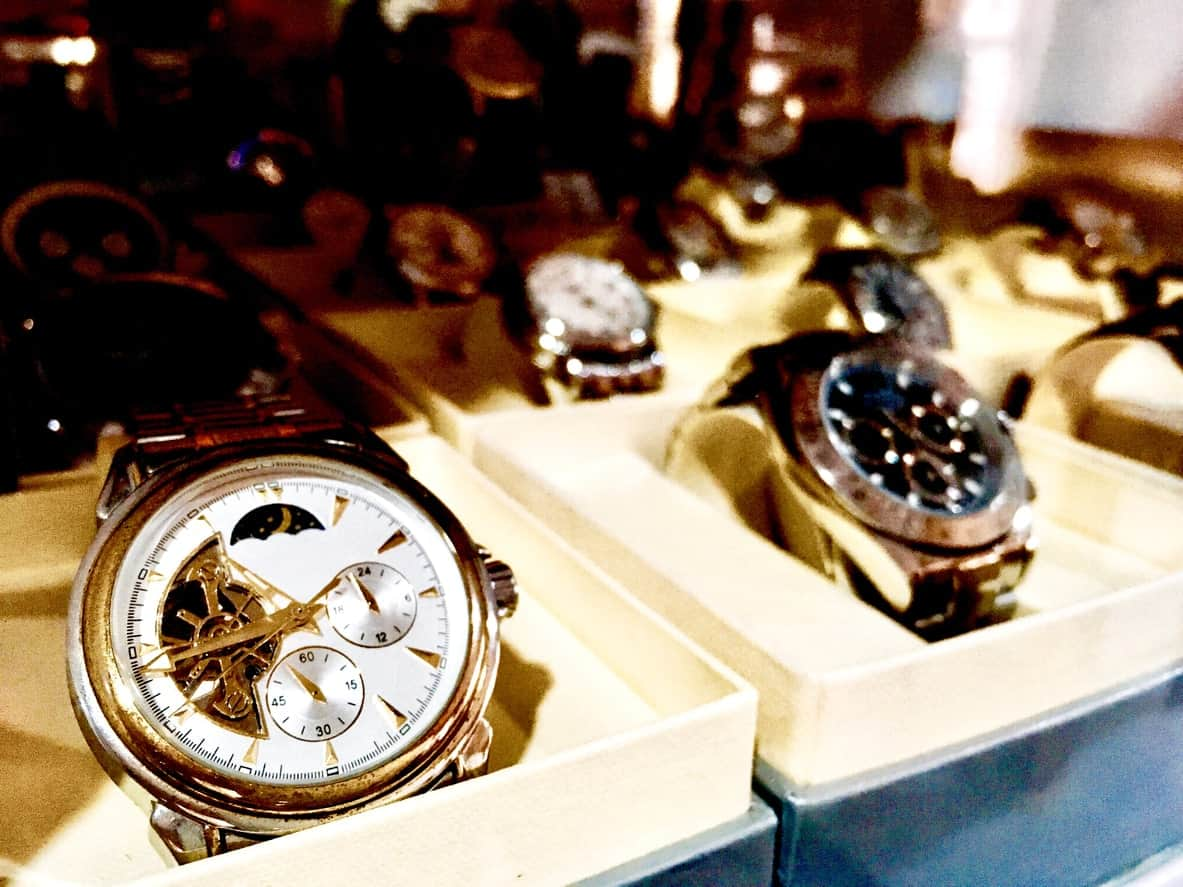 A display of wristwatches on individual storage boxes.