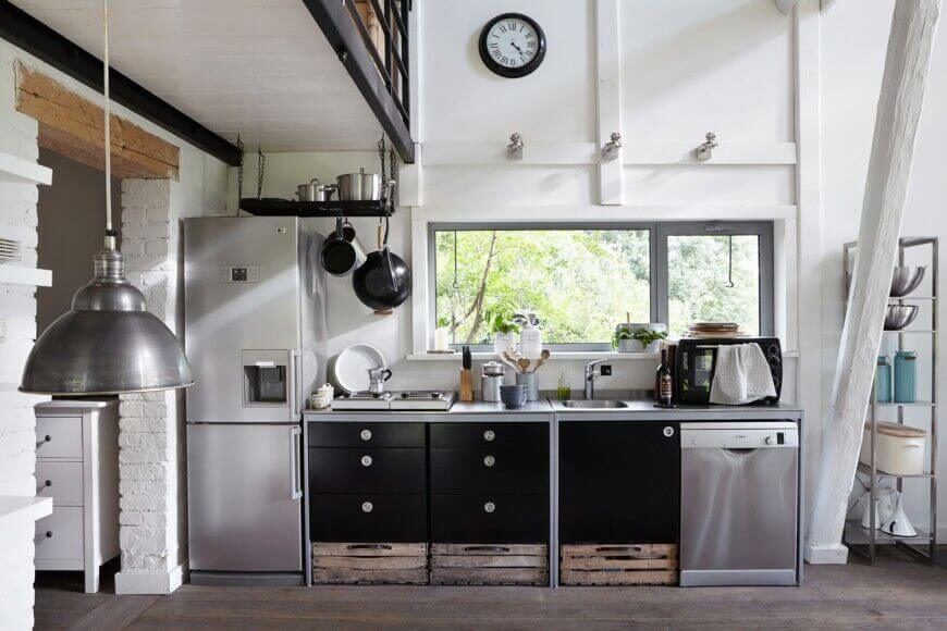 This small kitchen makes up for a lack of storage with the small pot rack suspended above the fridge. While the entire rack may not to accessible to hang things, this one is low enough that the top can be utilizes like a shelf for more storage.