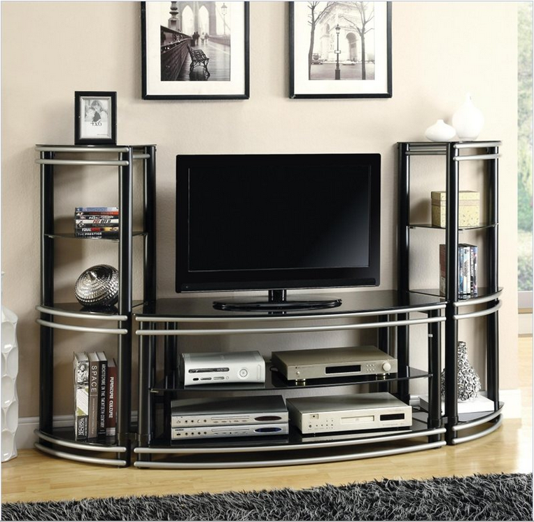 The smoothly curved metal construction and black glass surfaces on this unit inspire a sense of contemporary awe, adding a dose of forward looking style in a buttoned up color palette. This center would be perfect for any modern styled man cave, or could add a dose of intriguing contrast to a more traditionally styled space. The darker colors would do wonders in a bright room, as pictured.