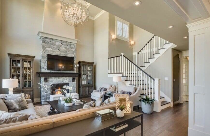This luxurious living room has a large authentic stone fireplace. The television fits nicely above the mantle and the fireplace has its own place to burn just below it.