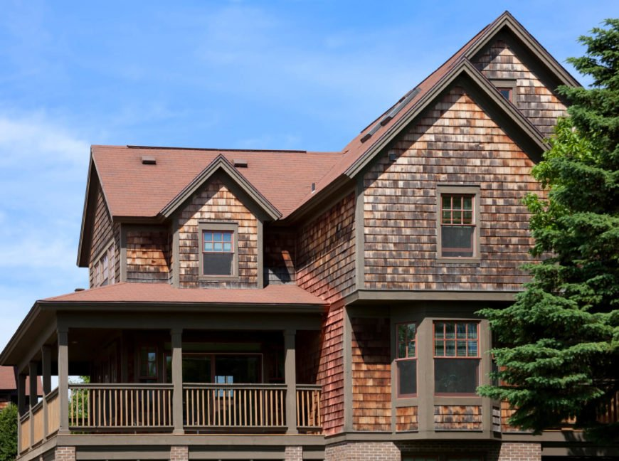 Shingles and shakes are similar in style and creation. Shakes are machine- or hand-sawn from blocks of wood to create thicker and less uniform, but more durable, covering for a house. Shingles are thinner and more uniform and are able to be cut into various shapes for more interest.