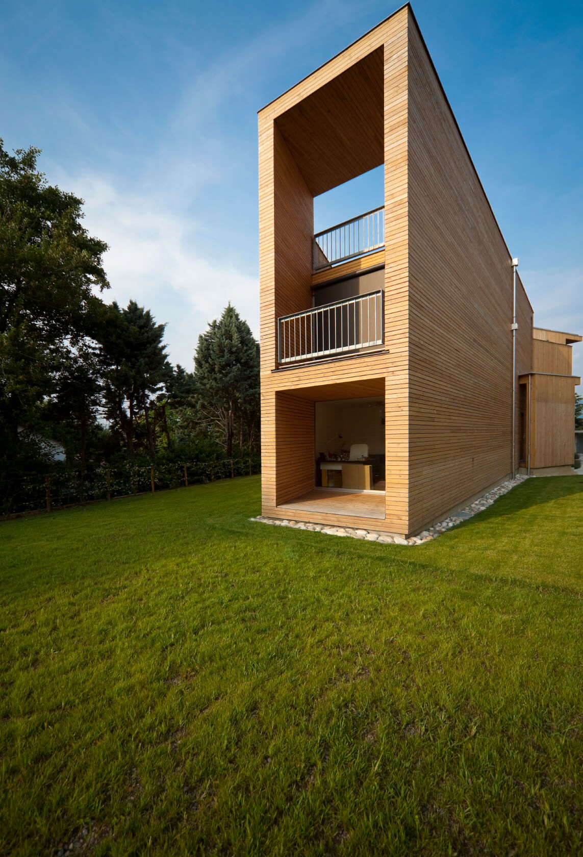 Thin wood boards can also be used as siding. Often installed in a tongue-in-groove style the boards can be placed horizontally or vertically but must have good waterproofing underneath them.
