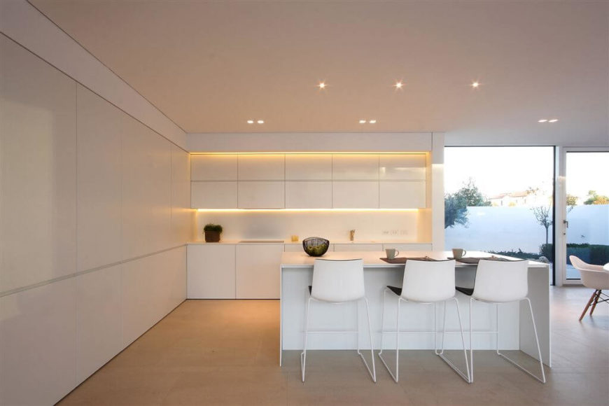 Under cabinet lighting can be a great way to get direct light to counters. It is also a nice way to highlight a beautiful design feature; these particular lights cast a lovely golden glow onto the cupboards and countertops.
