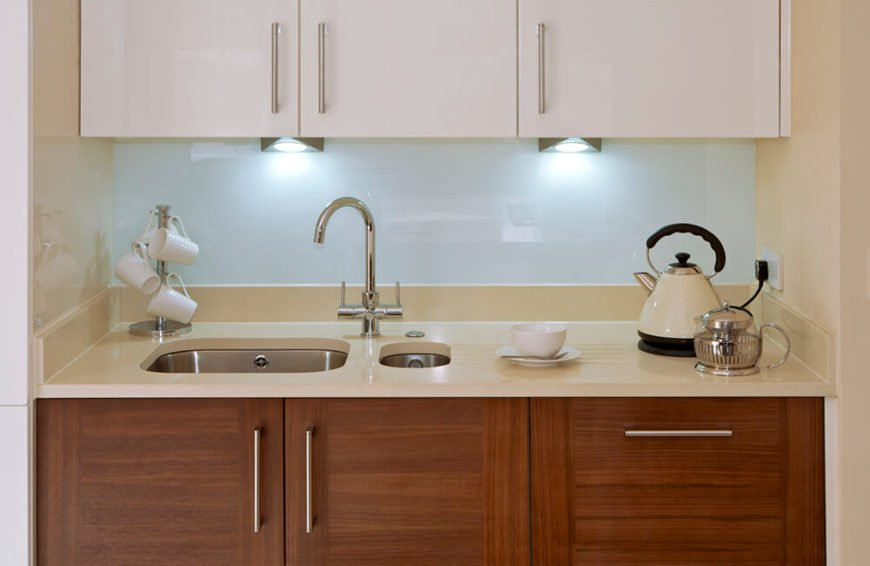 These uniquely shaped spotlights do a great job of lighting up the countertop of this little <a class=