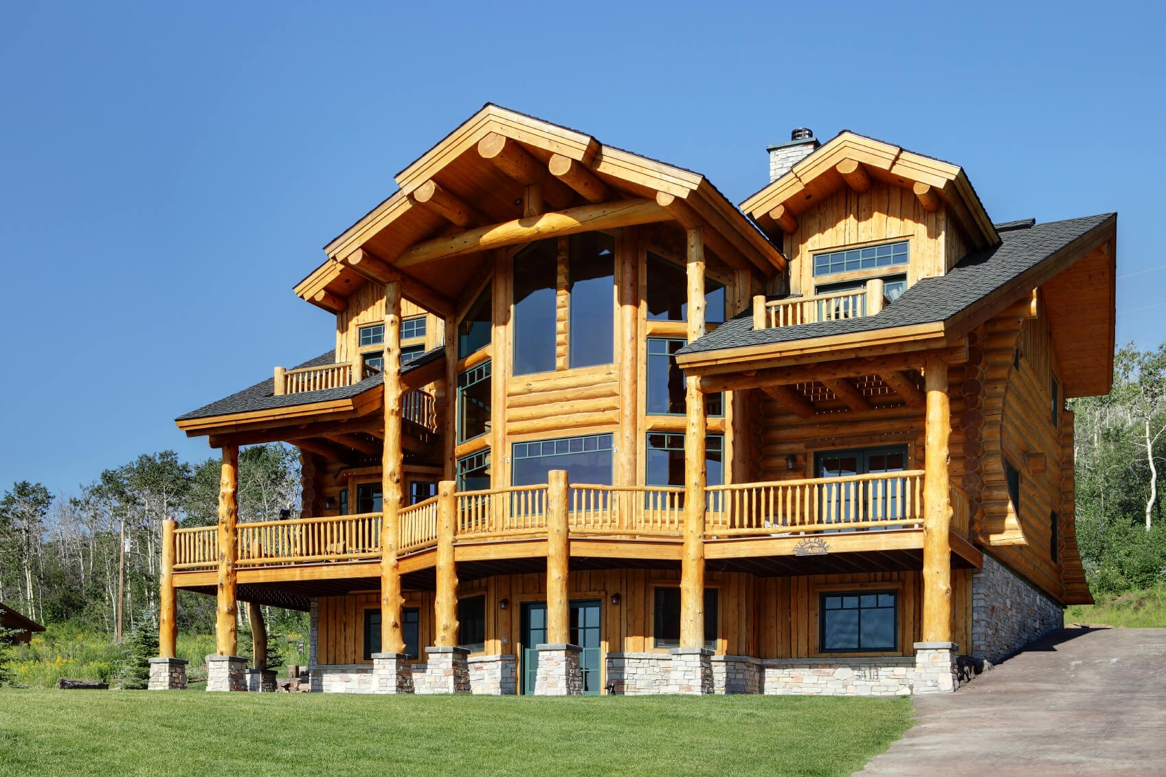 Split log siding is impressive on a house and offers instant rustic and cabin-like qualities. Typically made of cypress, cedar, redwood, or pine logs, split log siding is expensive and high-maintenance. It can be painted or stained but is most often used in its natural state with a clear-coat sealant over it.