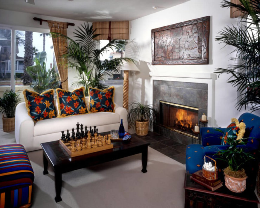 Bold colors and patterns brighten up this room considerably and balance the use of dark and light woods. Including house plants adds another color and makes the room feel more homey.