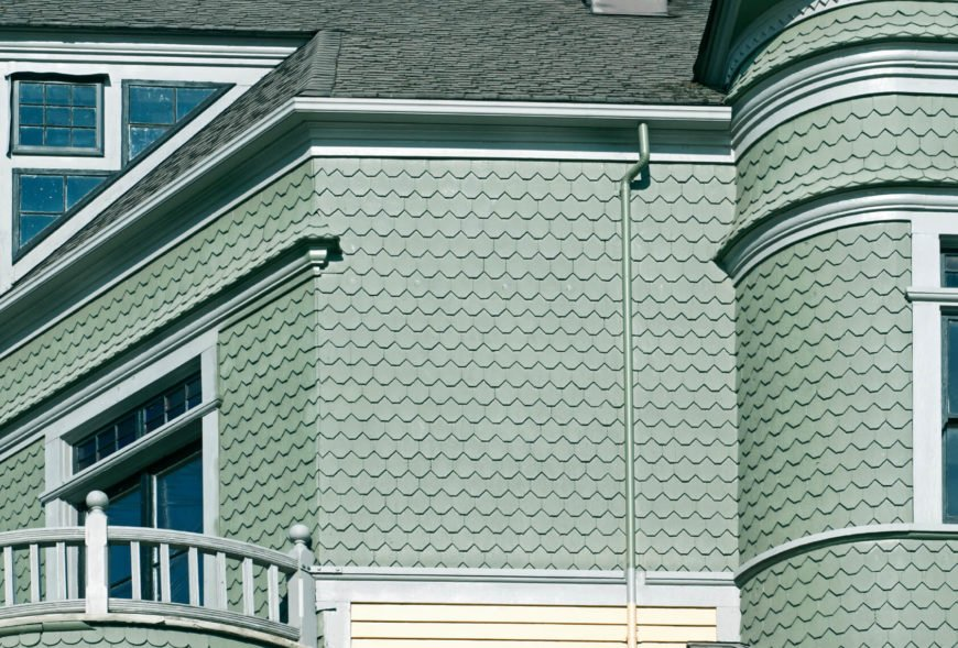 Here is a great example of shingles being cut in different shapes. These resemble fish scales overlapping one another to create a unique exterior texture to this house. Shingles and shakes are available in not only wood but also vinyl and fiber cement.