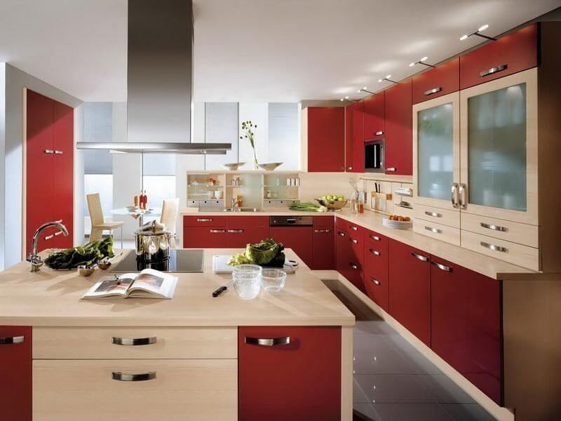While not entirely wall-mounted, these tiny little bar lights above the cabinets create a unique and interesting light feature in this kitchen. They supply a lot of light to the kitchen as a whole but they do draw the eye up along the striking red cabinets.