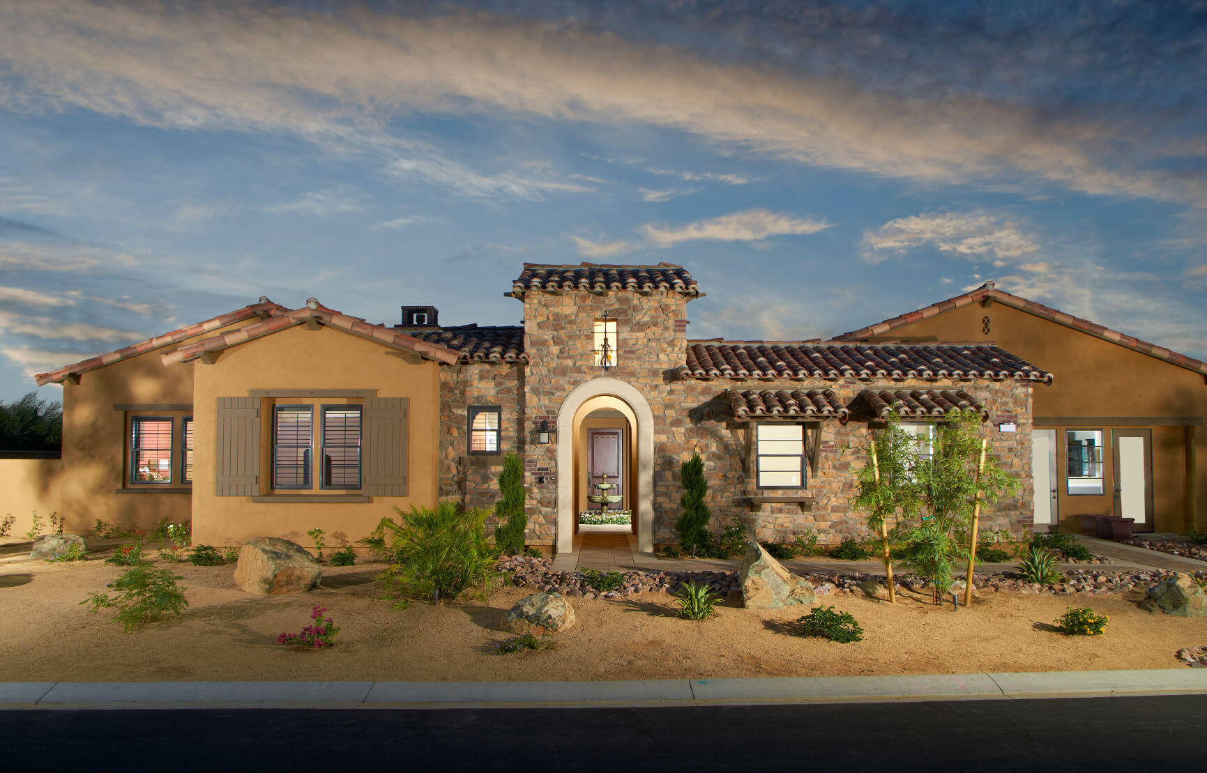 Here is a winning combination of stucco and stone. With there being so many recipes for making stucco, it can be a relatively reasonable price when compared to other exterior materials.