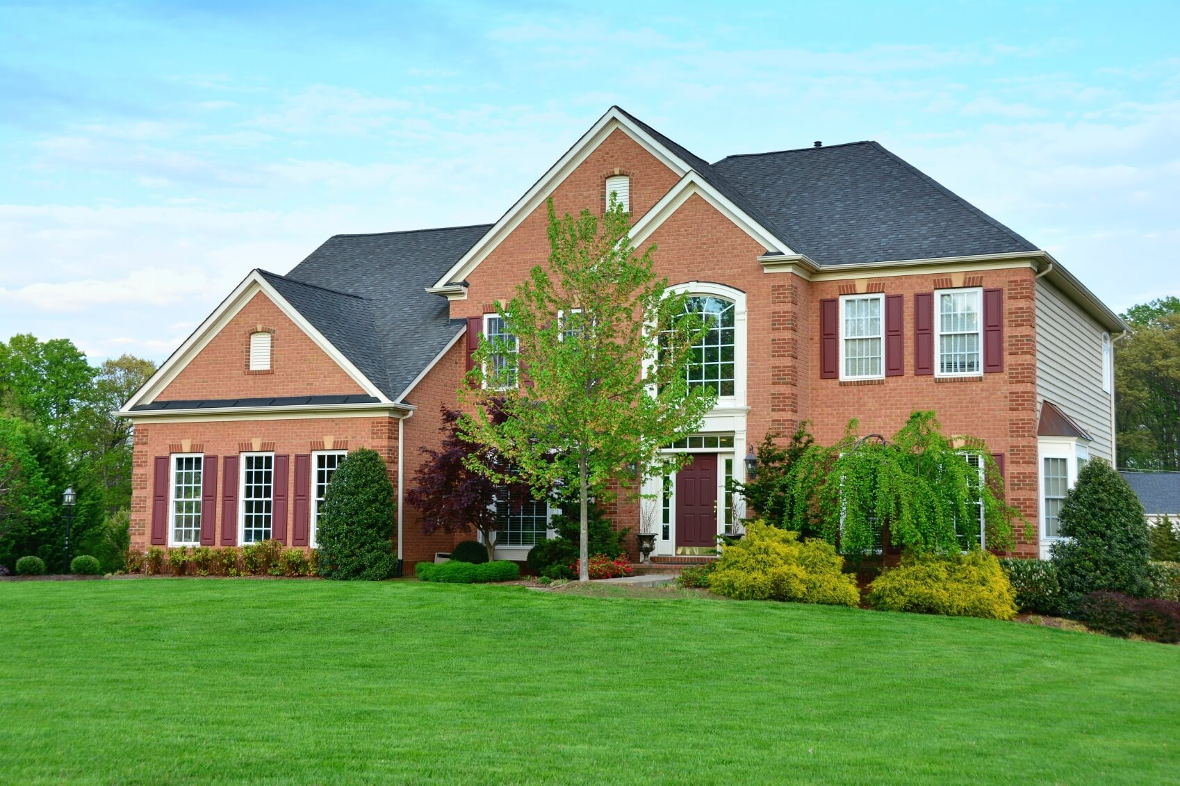 As seen here, a brick veneer is commonly used as an accent piece to a home while the rest of it is covered with siding or another material. Made of fired clay, bricks come in a variety of colors, sizes, textures, and designs. They can be stacked and laid in many different patterns to create a multitude of options.
