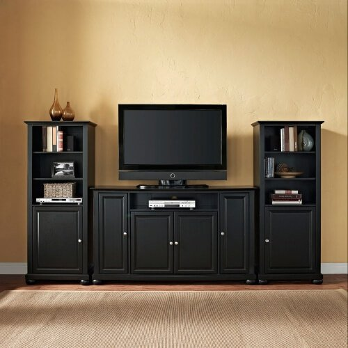 We love the simple yet elegant lines of this rich, dark stained wood entertainment center. The TV stand itself features a low, squat appearance for the ultimate in stability, while the flanking media towers offer additional shelving, display space, and enclosed cabinetry for all of your man cave needs. This one could work a nice contrast in a bright room or mix perfectly in a darker space.