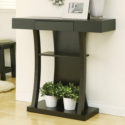 The curved legs of this table create a simple visual effect that makes the top feel as though it should be the same size as the bottom shelf.