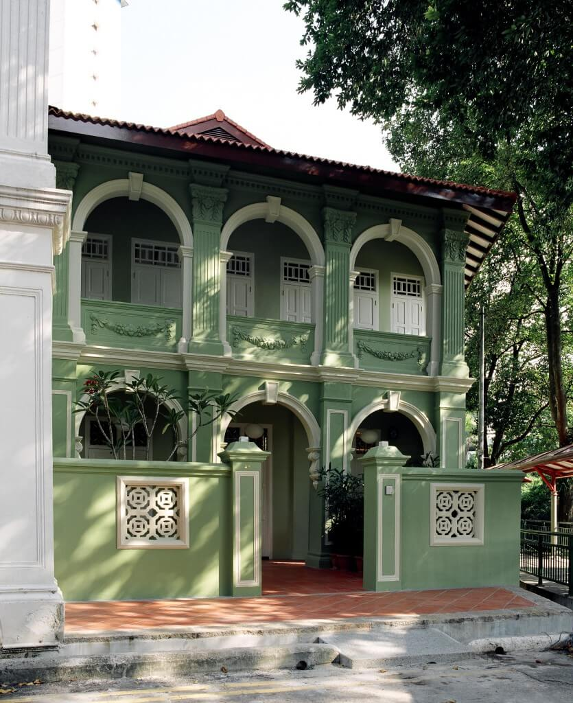 This mint green stucco creates an interesting look against the cream accents of this traditional oriental styled exterior. Warm terra cotta tiles contrast the green, like oxidized copper, for a fun touch.