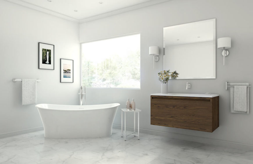 This pristine white bathroom features the W2 wave tub, a deep soaking tub that will ensure that your bath is as relaxing as you imagine all day. A slim floating vanity in oak adds texture and warmth to the room's design, and is topped by an enormous beveled mirror.
