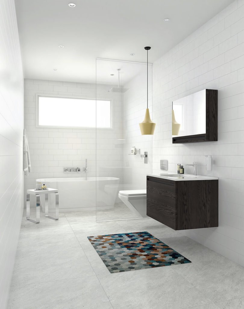 This bathroom features a space entirely tiled in classic white subway tile and features a wet room closed off by a half panel of glass. Behind it sits the commode and the W2 straight tub. On the other side of the glass panel is the rich oak vanity and the W2 Lift-Up Mirrored Cabinet, which conceals even more storage, similarly to a medicine cabinet.