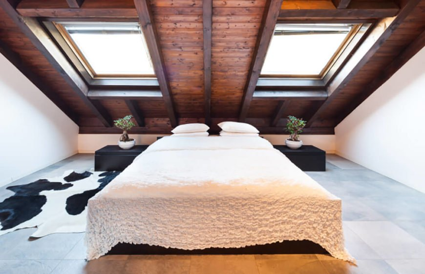 Here is another angle of the same room, this time showing off the bed and the stunning sloping ceiling better. Letting the ceiling be the highlight of the room means that the rest of the room should remain neutral in color.