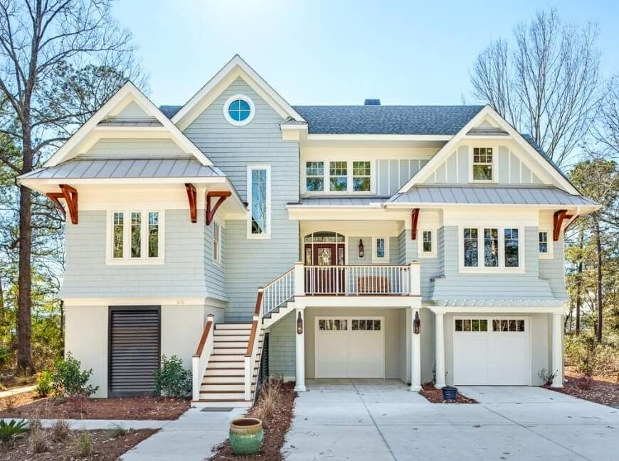 This combination of shingles and board and batten with the white and redwood accents creates a gorgeous look on this house. Sometimes a combination of exterior covering styles is the way to go to create the best design for your home.