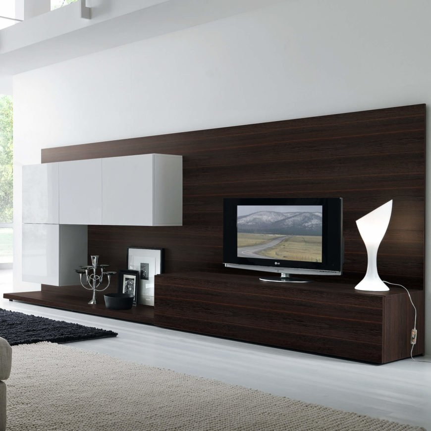 This is a truly ultra-modern entertainment center, all minimalist sharp angles, high contrast, and sleek textures. It's designed for a rather large room, so you'll want to be sure about your space limitations before picking up a unit like this. The backing panel acts as an accent wall, while the white cabinetry provides a visually stunning way to store your necessities.