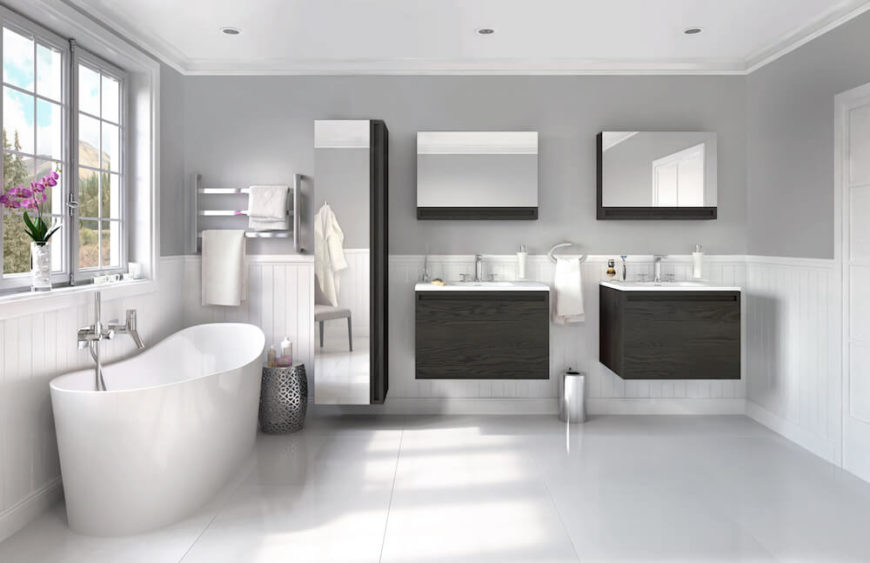 In a more roomy bathroom, the Wave tub is comfortably situated below a pair of windows, with a mirrored linen closet directly to the right, followed by two single vanities, each topped by a Lift-Up Mirrored cabinet.
