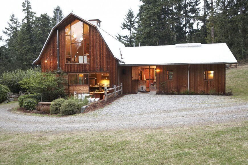 Originally used on barns and other farm buildings as a cheap and material-efficient covering, it is no longer as affordable as it once was. This house mimics a barn style so a board and batten exterior seems like a natural choice.