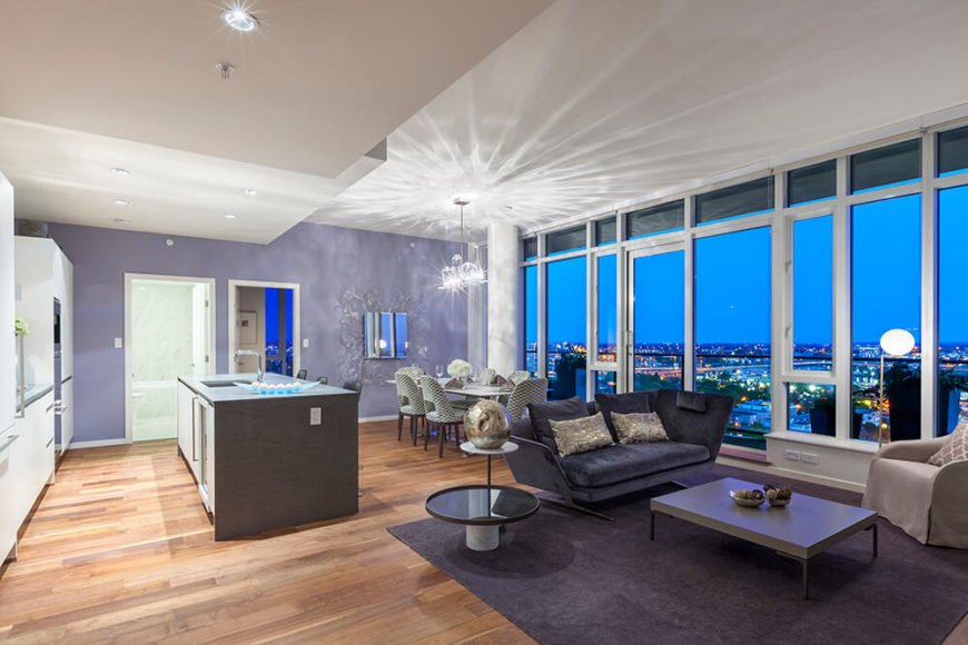 Moving back, we taken in a wider look at the large open-plan space at the center of this home. The all-glass exterior affords fantastic views from anywhere in here, including the living room and kitchen.