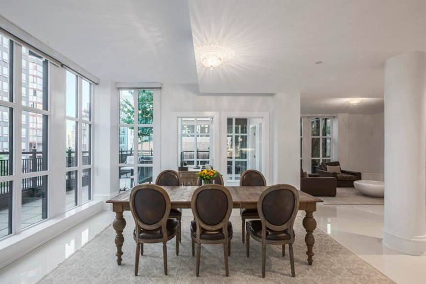 The dining room also follows the kitchens natural dark hardwood theme. The white surrounding the area really makes the dining set pop.