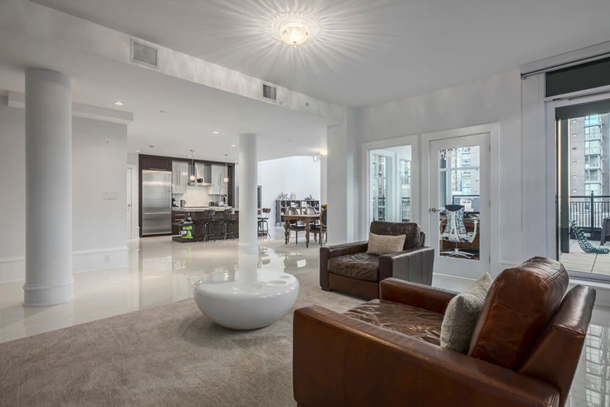 The open floor plan spreads far and wide from the living room and into the kitchen.