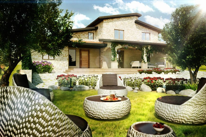 The light stone structure of the home and bright tiled roof reflect the sunny environment, evoking the history of the area in texture and tone. The shape of the structure, however, is all modern.
